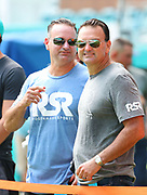 Sep 15, 2019; Miami Gardens, FL, USA;  Sports Agent Drew Rosenhaus and his brother Jason Rosenhaus watch pregame practice on the sideline before an NFL game between the Miami Dolphins and the New England Patriots at Hard Rock Stadium in Miami Gardens, FL. The Patriots beat the Dolphins 43-0. (Steve Jacobson/Image of Sport)