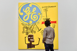 "© Licensed to London News Pictures. 23/06/2017. London, UK. Artist Bradley Theodore views ""Sweet Pungent"", 1984-85, a collaborative work by Andy Warhol and Jean-Michael Basquiat (estimate GBP1.4-1.8m) at the preview of Sotheby's Contemporary Art Sale in New Bond Street.  The auction, which is dominated by Pop art, takes place on 28 June. Photo credit : Stephen Chung/LNP"