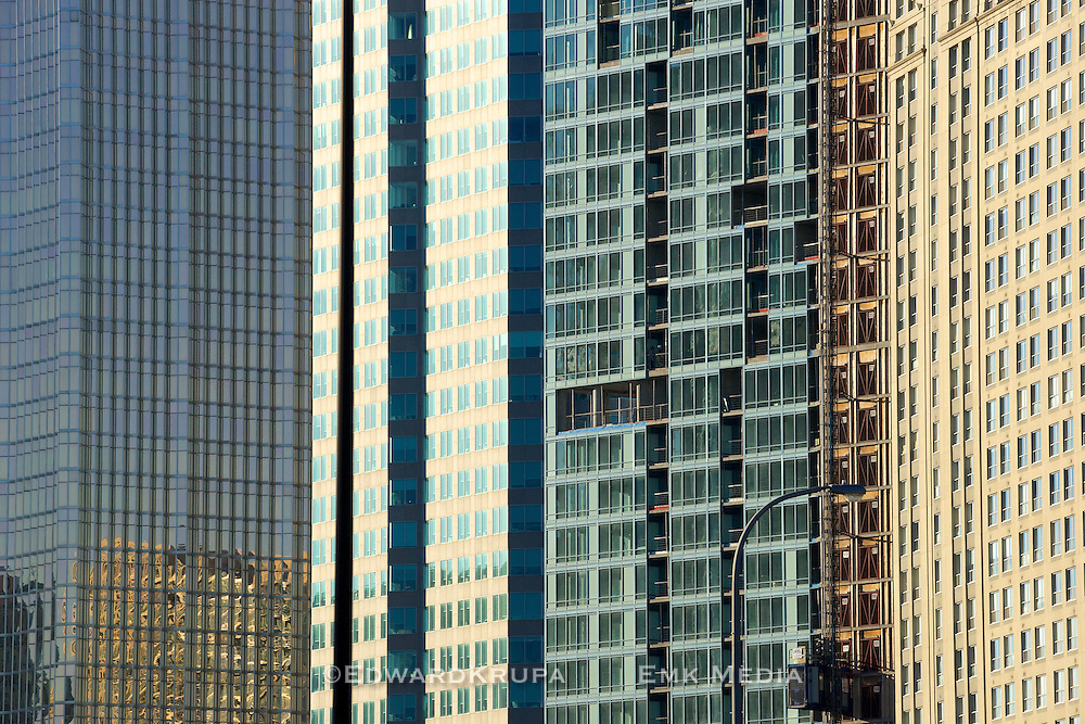 Windows of buildings in the ever crowding Toronto skyline.