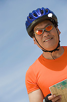 Senior man wearing cycling helmet