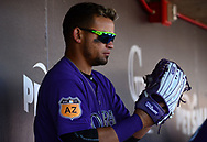 SCOTTSDALE, AZ - FEBRUARY 25:  Gerardo Parra #8 of the Colorado Rockies sits in the dugout during the spring training game against the Arizona Diamondbacks at Salt River Fields at Talking Stick on February 25, 2017 in Scottsdale, Arizona.  (Photo by Jennifer Stewart/Getty Images)