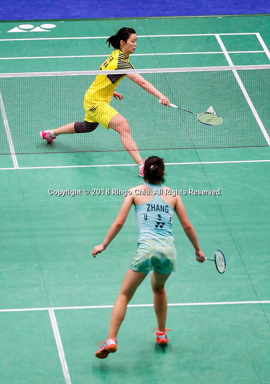 Li Xuerui (top) of China, competes with Beiwen Zhang of USA, during the women's singles final match at the U.S. Open Badminton Championships in Fullerton, California on June 17, 2018. Li won 2-1. (Photo by Ringo Chiu)<br /> <br /> Usage Notes: This content is intended for editorial use only. For other uses, additional clearances may be required.