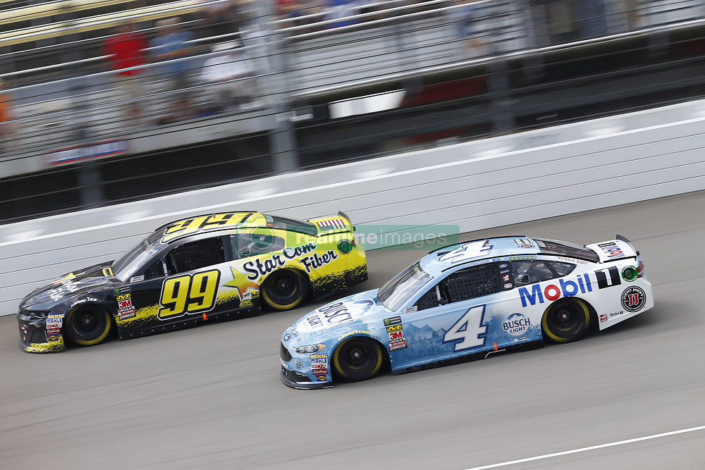 August 12, 2018 - Brooklyn, Michigan, United States of America - Gray Gaulding (99) and Kevin Harvick (4) battle for position during the Consumers Energy 400 at Michigan International Speedway in Brooklyn, Michigan. (Credit Image: © Chris Owens Asp Inc/ASP via ZUMA Wire)