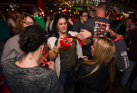 Heather Parent sells 50/50 raffle tickets to Donna Akerley and Trish Tryon during Pub Mania Thursday evening at Patrick's Pub and Eatery.  (Karen Bobotas/for the Laconia Daily Sun)