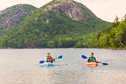 A couple kayaking on Jordan Pond in Maine's Acadia National Park.