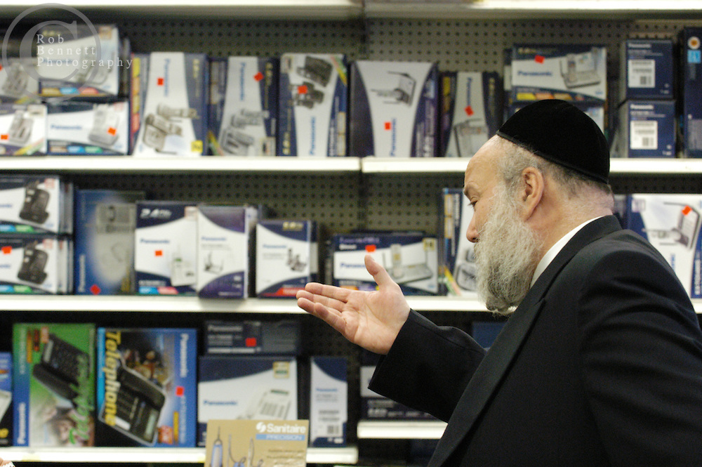 Here, Joseph Kizelnik (845-352-3725) in the store he owns with his wife, Auction Mart (75 Route 59, Monsey, NY). He spoke with The NY Times about the Wal-Mart and why he is opposed to it, from a business and a religious standpoint..---.Thursday, June 15, 2007 - Monsey, NY - Orthodox and Hasidic communities oppose Wal-Mart - Religious leaders, business owners and residents in this heavily Orthodox Jewish community in Rockland County have organized to wage a quiet, yet strong opposition to the construction of a Wal-Mart Super Center. In addition to concerns about increased traffic on Route 59, a two-lane state highway with a Main Street feel, the opponents see Wal-Mart as an unwieldy anchor of modernity in an otherwise insulated world steeped in religious tradition...Credit: Rob Bennett for The New York Times