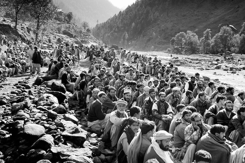 The men walked for days to get to the helicopter landing site in the Kagan valley, but when they got there the emergency relief had run out, so they were forced to wait. The journey was too hard for the women who had lost their husbands; they could not carry the 50 kilo winter tents back up over the mountains, and so had to hope for help from their neighbours. Nov. 2005