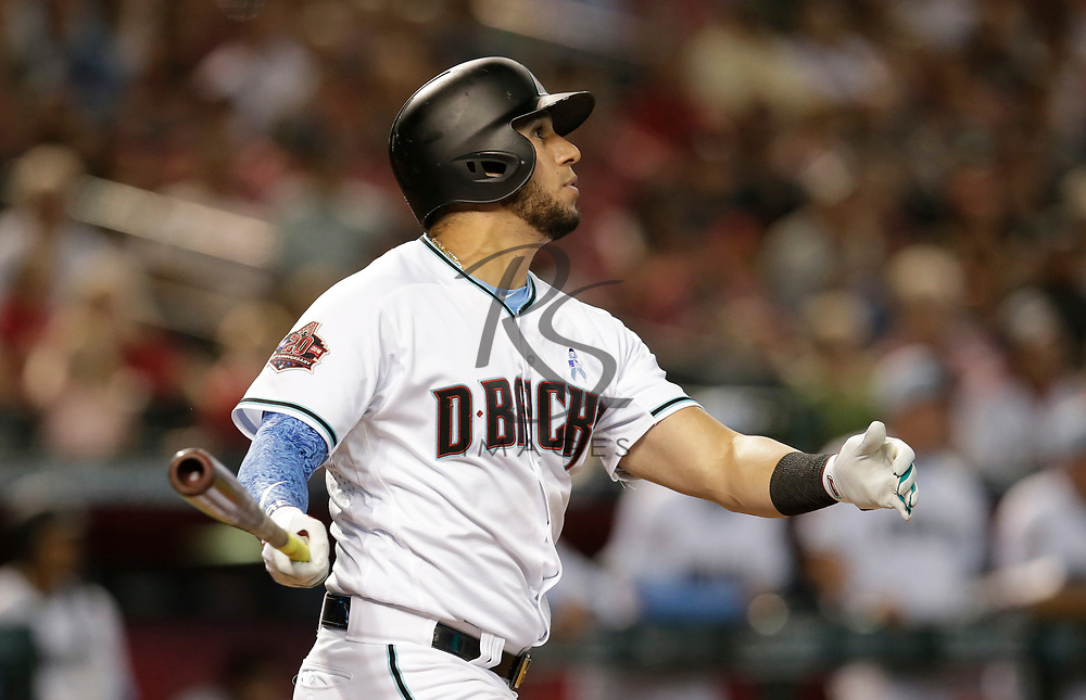 Arizona Diamondbacks David Peralta hits an RBI double against the New York Mets in the fourth inning during a baseball game, Sunday, June 17, 2018, in Phoenix. (AP Photo/Rick Scuteri)