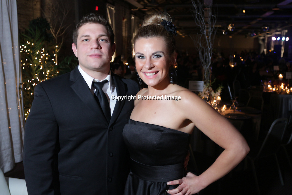 Brandon Ewers, left, and Makenzi Henderson pose for a picture during the Diamonds and Champagne Hope Ball Saturday November 22, 2014 at the Coastline Convention Center in Wilmington, N.C. (Jason A. Frizzelle)