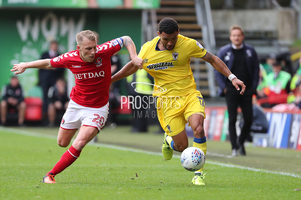 AFC Wimbledon striker Andy Barcham (17) battles for possession with Charlton Athletic midfielder Chris Solly (20)  during the EFL Sky Bet League 1 match between Charlton Athletic and AFC Wimbledon at The Valley, London, England on 28 October 2017. Photo by Matthew Redman.