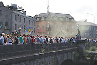 Crowds line O'Brien Bridge Galway for the Arts Festival Parade