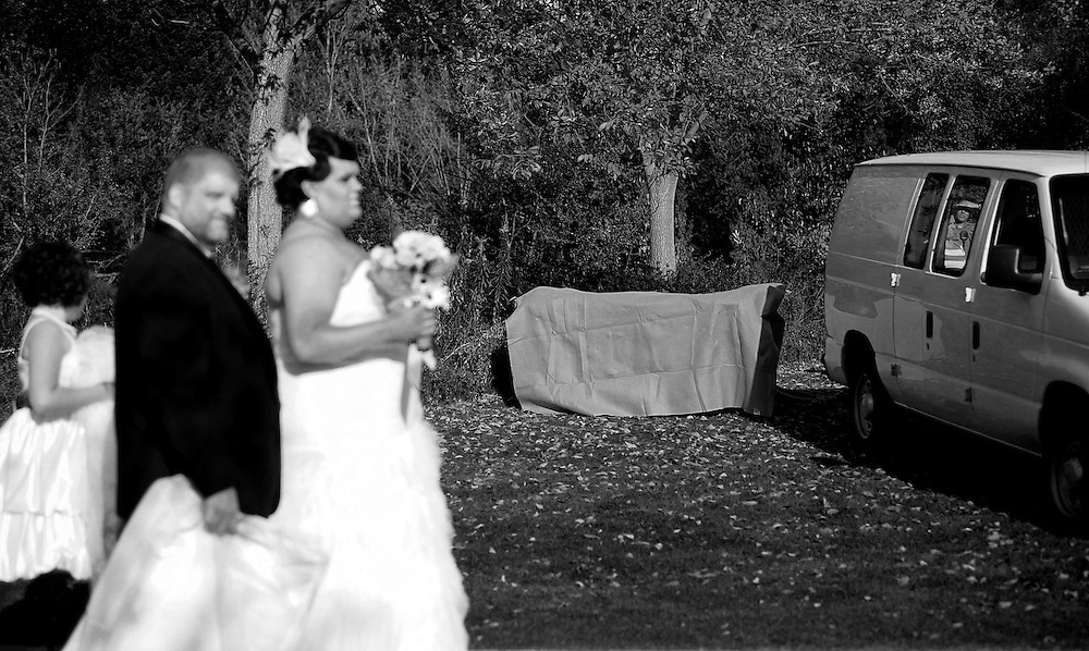 Wedding Death<br /> Newlyweds Justin and Whitney Alderson walk past a body that was being loaded into an Ada County Coroner van after it was pulled out of a pond at Kathryn Albertson Park in Boise, Idaho. The couple said the discovery, which was made by a relative who attended the wedding, didn't disrupt the wedding ceremony. &quot;It was kind of weird, but the police were very discrete and nice&quot; said Justin. &quot;It will definitely give us something to remember&quot;, added Whitney. Saturday October 25, 2014<br /> AP PHOTO KYLE GREEN / THE IDAHO STATESMAN