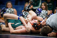 Coeur d'Alene High's Hudson Staub looks toward the official to call the pin as he tries to keep Klint Brown from Lakeside High in position during the 125-pound match Wednesday.