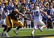 September 4 2010: Eastern Illinois Panthers quarterback Brandon Large (10) tries to avoid Iowa Hawkeyes defensive end Adrian Clayborn (94) and Iowa Hawkeyes defensive tackle Christian Ballard (46) during the first quarter of the NCAA football game between the Eastern Illinois Panthers and the Iowa Hawkeyes at Kinnick Stadium in Iowa City, Iowa on Saturday September 4, 2010. Iowa defeated Eastern Illinois 37-7.