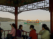 lake with boats at the Summer Palace park in Beijing