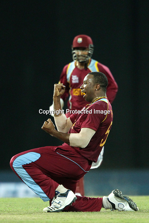 Kieron Pollard of The West Indies celebrates the wicket of George Bailey (Captain) during the ICC World Twenty20 semi final match between Australia and The West Indies held at the Premadasa Stadium in Colombo, Sri Lanka on the 5th October 2012<br /> <br /> Photo by Ron Gaunt/SPORTZPICS