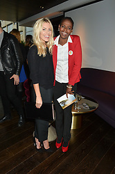 Left to right, MOLLIE KING and JOHANNA SATEKGE at the mothers2mothers World AIDS Day VIP Lunch with Next Management & THE OUTNET.COM held at Mondrian London, 19 Upper Ground, London on 1st December 2014.