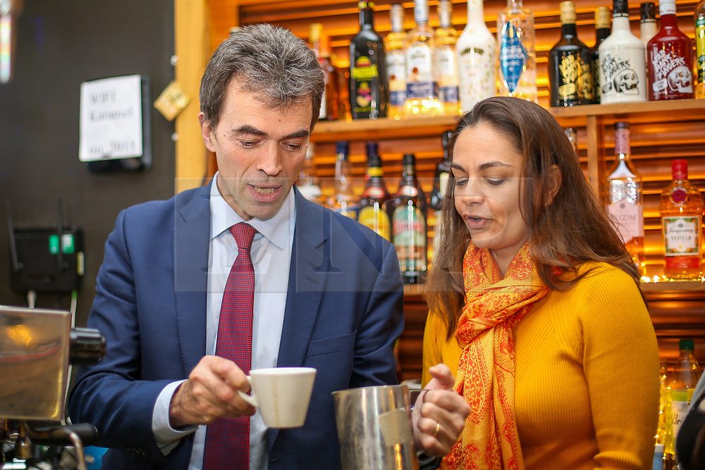 © Licensed to London News Pictures. 21/11/2019. London, UK. Liberal Democrat Shadow Brexit Secretary, TOM BRAKE makes a cup of coffee as he and London Mayoral candidate, SIOBHAN BENITA visit Karamel Cafe - a creative regeneration charity in Hornsey and Wood Green, north London. Photo credit: Dinendra Haria/LNP