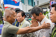 04 AUGUST 2013 - BANGKOK, THAILAND: Gen. PREECHA IAMSUPHAN, leader of the People's Army against Thaksin Regime (left), greets supporters at an anti-government rally in Bangkok. About 2,000 people, members of the  People's Army against Thaksin Regime, a new anti-government group, protested in Lumpini Park in central Bangkok. The protest was peaceful but more militant protests are expected later in the week when the Parliament is expected to debate an amnesty bill which could allow Thaksin Shinawatra, the exiled former Prime Minister, to return to Thailand.       PHOTO BY JACK KURTZ
