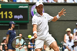 © Licensed to London News Pictures. 12/07/2019. London, UK. Roberto Bautista Agut of Spain plays Novak Djokovic of Serbia  <br /> in the men's singles semi-finals on centre court on Day 11 of the Wimbledon Tennis Championships 2019 held at the All England Lawn Tennis and Croquet Club. Photo credit: Ray Tang/LNP