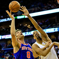 Mar 28, 2016; New Orleans, LA, USA; New York Knicks center Robin Lopez (8) and New Orleans Pelicans center Alexis Ajinca (42) battle for a rebound during the second quarter of a game at the Smoothie King Center. Mandatory Credit: Derick E. Hingle-USA TODAY Sports