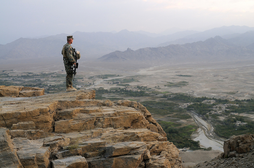 "US Marine Colonel Jeff Haynes, Commanding Officer, 201st Regional Corps Advisory Command, on a ridge overlooking the Tagab Valley. ..  ..One of the main tactics is a new road through Tagab Valley that will allow traffic to bypass Kabul providing a more direct link between Pakistan and destinations north including Uzbekistan and Tajikistan.....To win the Tagab Valley, Colonel Haynes said, ""The creeping barrage of goodness, really centers on the road going up the valley, because then you can begin development projects and increase prosperity.  The cab fare for villagers went from $8 down to $1 just because the ANA graded the road.""  As the ANA move north through the valley they are building combat outposts to sustain the gains.  Haynes confirmed this is an ANA campaign - the first of its kind - his soldiers are mentoring the ANA, there are no coalition troops.  .."