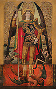 The Archangel St Michael, trampling on the devil, 1455-60, tempera, stucco reliefs and gold leaf, by Jaume Huguet, 1412-92, in Gothic style, in the Museu Nacional d'Art de Catalunya, Barcelona, Spain. This is the central panel of the altarpiece of St Michael of the Retailers, originally from the Chapel of the Shopkeepers' and Retailers' guild, in the church of Santa Maria del Pi, Barcelona. The MNAC keeps 5 more panels from this altarpiece. This panel was repainted in the 17th or 18th century because the original was damaged, probably by the candles lit as offerings. Picture by Manuel Cohen