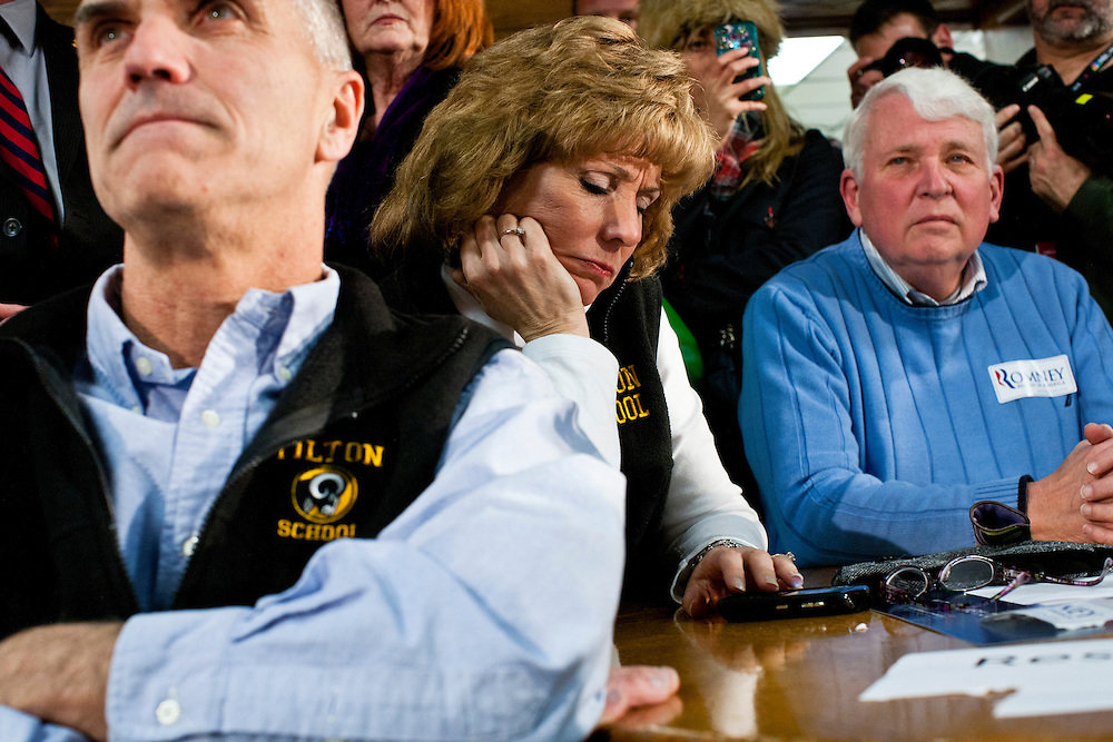 People listen as Republican presidential candidate Mitt Romney hosts a spaghetti dinner on Friday, January 6, 2012 in Tilton, NH.