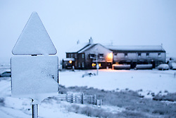 © Licensed to London News Pictures. 21/11/2018. Richmond UK. Britains highest pub, the Tan Hill Inn that sits at 1732ft above sea level on the Pennine Way in North Yorkshire & has been covered in snow this morning. Photo credit: Andrew McCaren/LNP