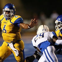 Tupelo quarterback Stephon McGlaun makes a carry during Friday night's game against Oxford.