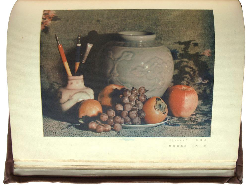 Nihon Shashin Bijutsu Nenkan Dai Ichinen Han<br /> (Japan Photo Art Annual First Ed.)<br /> Published 1926 (Taisho year &rsquo;16).<br /> Collotype plates by Hakuyo Fuchigami<br /> <br /> Catalogue of the first Japan Photographic Art Exhibition held at the Daimaru Dry Goods Store in Osaka in May 1926, sponsored by the Osaka Mainichi and the Tokyo Nichinichi newspapers. This fine publication features many of the best Japanese art photographers of that era including Takayama Masataka, Kajiwara Keibun, Yasui Nakaji, Kobayashi Yuji, Yamamoto Makihiko, Fukuda Katsuji, Furukawa Narutoshi, Nishi Kikuji, Kometani Koro, Umesaka Ori, Sakakibara Seiyo, Fukumori Hakuyo and Fuchigami Hakuyo. Large format publication with 168 gilded pages, overlapping velvet cover and inside letterpress cover in gold ink. A total of 172 illustrations including:<br /> <br /> - Single, duotone and full color rotogravures (148). <br /> - Full page collotype plates on laid paper (18).<br /> - Full page color collotype plate on laid paper (1)<br /> - Full page hand pulled photogravure (1). <br /> <br /> Editor and publisher Hakuyo Fuchigami, published by Nihon Shashin Bijutsu Nenkan Kanko Kai.<br /> - Printing date November 30, 1926.<br /> - Publishing date December 2, 1926. <br /> <br /> Size: 9 1/4 in. x 12 in. x 3/4 in. (240 mm x 300 mm x 20 mm),<br /> <br /> Condition: Velvet cover shows some signs of wear. Pages are mostly clean and in very good condition. Slipcase is absent.<br /> <br /> <br /> <br /> <br /> <br /> <br /> <br /> <br /> <br /> <br /> <br /> <br /> <br /> <br /> <br /> <br /> <br /> <br /> <br /> <br /> <br /> <br /> <br /> <br /> <br /> <br /> <br /> <br /> <br /> <br /> <br /> <br /> <br /> <br /> <br /> <br /> <br /> <br /> <br /> <br /> <br /> <br /> <br /> <br /> <br /> .