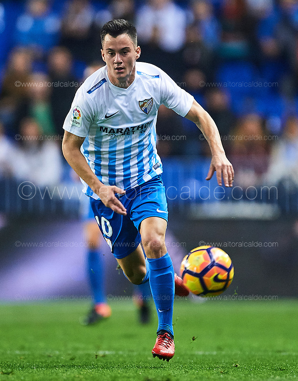 "MALAGA, SPAIN - DECEMBER 09:  Juan Pablo Anor ""Juanpi"" of Malaga CF in action during La Liga match between Malaga CF and Granada CF at La Rosaleda Stadium December 9, 2016 in Malaga, Spain.  (Photo by Aitor Alcalde Colomer/Getty Images)"