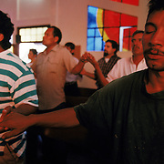 Twenty-two year old migrant Carmel Sanchez prays at Casa Del Migrante shelter in Tijuana, Mexico. Please contact Todd Bigelow directly with your licensing requests. PLEASE CONTACT TODD BIGELOW DIRECTLY WITH YOUR LICENSING REQUEST. THANK YOU!