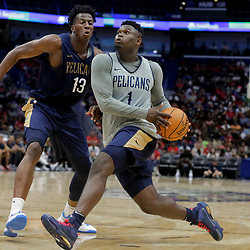 Oct 5, 2019; New Orleans, LA, USA; New Orleans Pelicans forward Zion Williamson (1) drives past center Kavell Bigby-Williams (13) during a open practice at the Smoothie King Center. Mandatory Credit: Derick E. Hingle-USA TODAY Sports