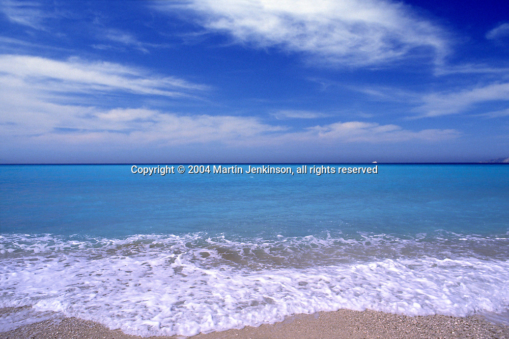 Wave breaks on the shore at Lourdas beach, Kefalonia Greece....travel, lifestyle