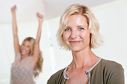 Close up of mother with excited daughter raising hands