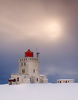VIK, ICELAND - CIRCA MARCH 2015: View of the Dyrhólaey Lighthouse close to Vik during winter time in Iceland