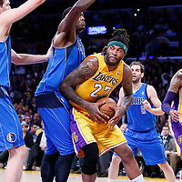 04 April 2014: Los Angeles Lakers forward Jordan Hill (27) drives past Dallas Mavericks center Samuel Dalembert (1) during the Dallas Mavericks 107-95 victory over the Los Angeles Lakers at the Staples Center, Los Angeles, California, USA.