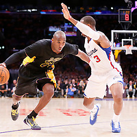 31 October 2014: Los Angeles Lakers guard Kobe Bryant (24) drives past Los Angeles Clippers guard Chris Paul (3) during the Los Angeles Clippers 118-111 victory over the Los Angeles Lakers, at the Staples Center, Los Angeles, California, USA.