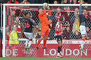 Brentford goalkeeper Luke Daniels (28) makes a save during the The FA Cup match between Brentford and Stoke City at Griffin Park, London, England on 4 January 2020.
