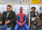 UNITED KINGDOM, London: 23 October 2015. <br /> Comic Con Feature.<br /> 'Spider-Man' (Aziz Jouhargi) uses a more conventional mode of transport to get himself to the 2015 MCM London Comic Con which was held at London's ExCel Arena.<br /> Photo: Rick Findler / Story Picture Agency