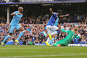 forward Romelu Lukaku gets caught offside as goalkeeper Joe Hart attempts to block his shot during the Barclays Premier League match between Everton and Manchester City at Goodison Park, Liverpool, England on 23 August 2015. Photo by Simon Davies.