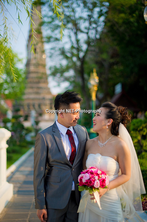 Bangkok  Thailand - Edith and Joe's prewedding (prenuptial, engagement session) at Wat Arun in Bangkok , Thailand.<br /> <br /> Photo by NET-Photography<br /> Bangkok  Thailand Wedding Photographer<br /> info@net-photography.com<br /> <br /> View this album on our website at http://thailand-wedding-photographer.com/bangkok-pre-wedding-session-couple-macau/?utm_source=photoshelter&amp;utm_medium=link&amp;utm_campaign=photoshelter_photo