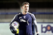 AFC Wimbledon goalkeeper Joe McDonnell (24) warming up during the EFL Trophy match between AFC Wimbledon and Luton Town at the Cherry Red Records Stadium, Kingston, England on 31 October 2017. Photo by Matthew Redman.