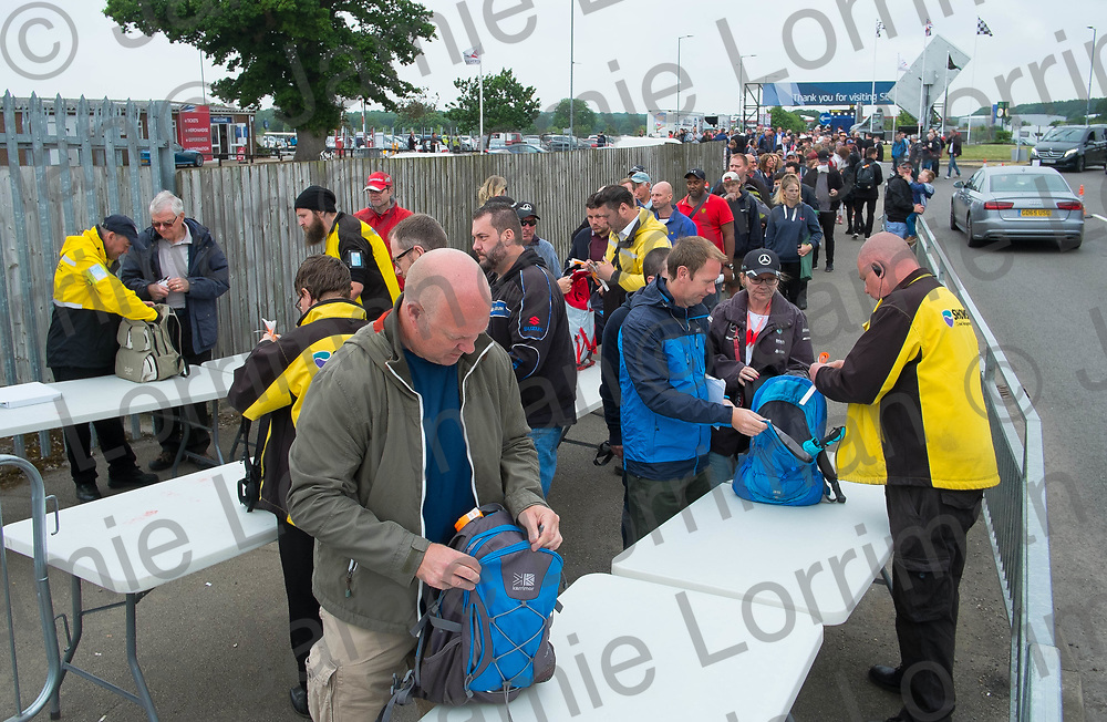 The 2017 Formula 1 Rolex British Grand Prix at Silverstone Circuit, Northamptonshire.<br /> <br /> Pictured: Fans queue to enter Silverstone Circuit as every bag is searched by security.<br /> <br /> Jamie Lorriman<br /> mail@jamielorriman.co.uk<br /> www.jamielorriman.co.uk<br /> +44 7718 900288