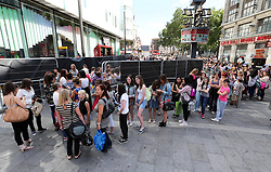 Hundreds of One Direction fans queueing in Leicester Square in London for the world premiere of the bands film One Direction: This Is Us,Tuesday, 20th August 2013. Picture by Stephen Lock / i-Images