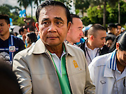 09 JANUARY 2016 - BANGKOK, THAILAND:        PRAYUTH CHAN-O-CHA, the Prime Minister of Thailand, walks through crowd at Government House during Children's Day festivities at Government House. National Children's Day falls on the second Saturday of the year. Thai government agencies sponsor child friendly events and the military usually opens army bases to children, who come to play on tanks and artillery pieces. This year Thai Prime Minister General Prayuth Chan-ocha, hosted several events at Government House, the Prime Minister's office.       PHOTO BY JACK KURTZ