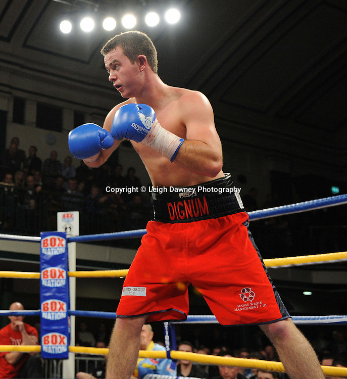 John Dignum (red shorts) defeats Ryan Clark in 4x3 min Super-middleweight contest at York Hall, Bethnal Green, London on Friday 13th January 2012. Queensbury Promotions © Leigh Dawney 2012
