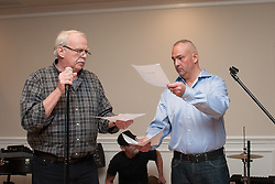 Police Chief Phil Tavares assisted John Hall in the announcement of the silent auction winners at Haddad's Ocean Cafe.