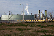 "Marathon refinery is located  across from  the Mississippi River in the stretch between Baton Rouge and New Orleans,  is part of a large concentration of chemical and oil companies that was formerly referred to as the ""Petrochemical Corridor,"" but now is know as ""Cancer Alley.""  Many cases of cancer have occurred  in communities on both sides of the river though the Louisiana Tumor Registry claims the numbers are not higher then the national average. The record high levels of the Mississippi River in the spring of 2011 brought on by what some scientists classify as climate change,  threaten the environment with the potential flooding of industrial complexes and nuclear facilities along the river."